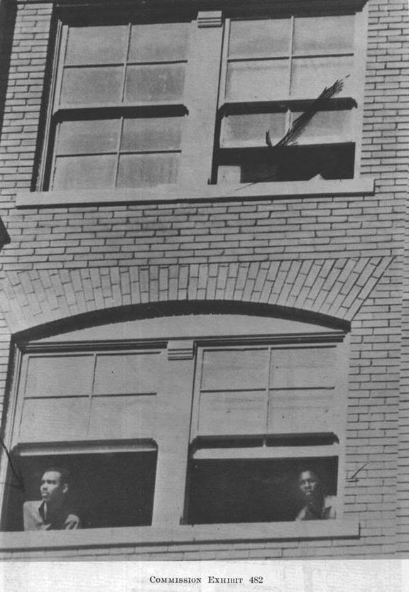 Williams and Norman looking out from the school book depository